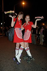 Girls in costume as car hops