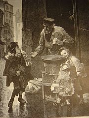 children buying roasted chestnuts