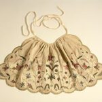 decorative apron worn over the skirt