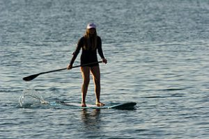 Woman on stand-up paddle board