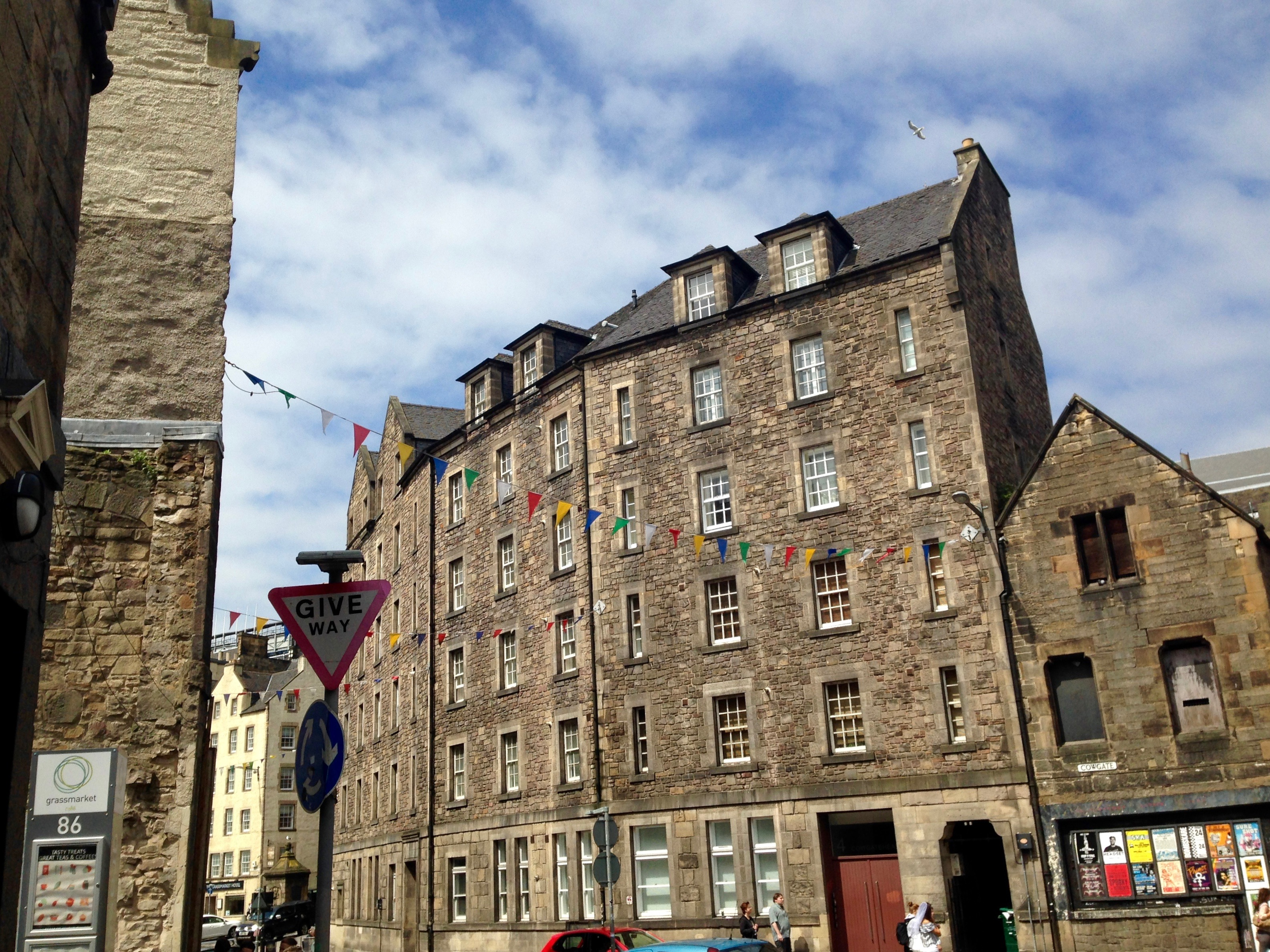 COMMUTING PAST GRASSMARKET, EDINBURGH