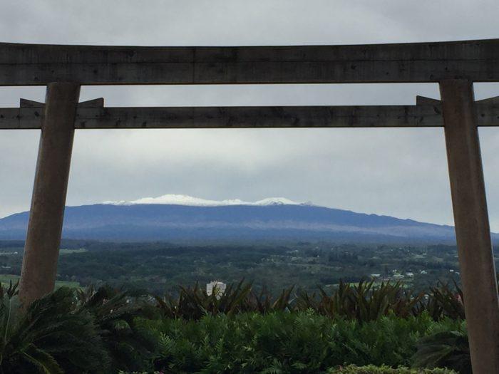 Torii facing snow covered Mauna Kea. Liliuokalani Gardens