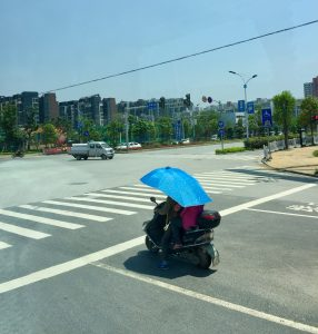 Sunshade on a motor scooter, Guilin