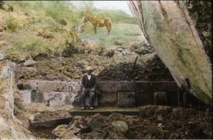 Man_sitting_on_Incan_ruins_in_Peru