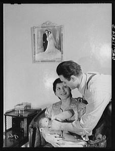 Mr._and_Mrs._Frank_Romano_feeding_their_baby.8d11642v