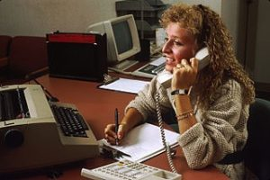 Receptionist answering phone.