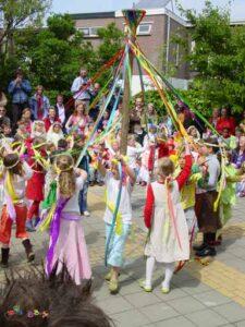 Children dance around a Maypole