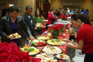 Soldiers and civilians of Headquarters and Headquarters Battalion, with their spouses and children, came together for a great family event in the spirit of the season at Patton Hall for the Family Readiness Group holiday party Dec. 14. (U.S. Army photo by Sgt. 1st Class Tim Meyer, U.S. Army Central Public Affairs.)
