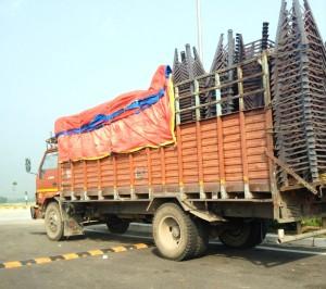 Overloaded orange truck